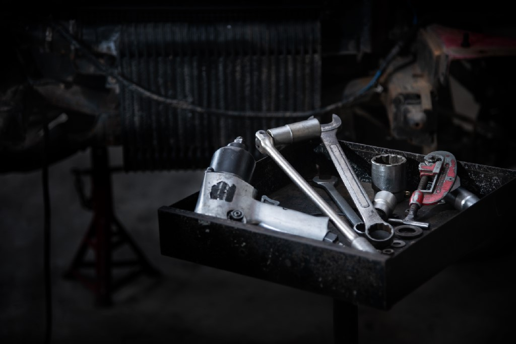 Tools for repairing many cars that are placed on the tool tray, mechanical tools. Professional mechanic using different tools for working in auto repair service